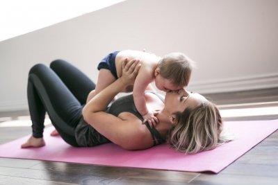 ma yoga mom yoga kissing baby